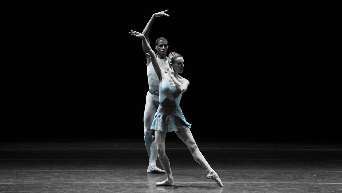 María Álvarez and Lawrence Rines in blue costumes with otherwise black and white image