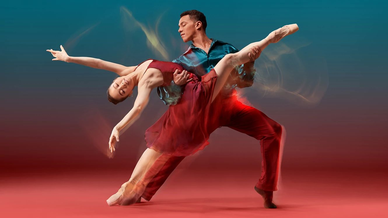 Seo Hye Han in a red dress and Irlan Silva in red pants and teal top against a red and teal background