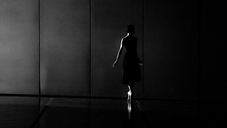 Female ballet dancer in dark light